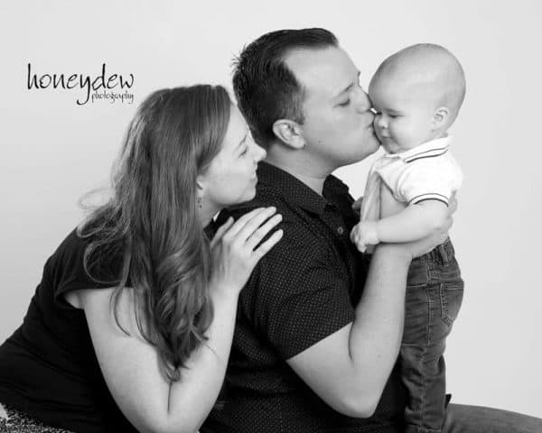 family photography Sydney baby smiling holding hands