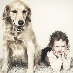 Pet photography Sydney A grumpy looking child posing with her dog